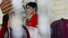 Shot of a Indian groom with bride standing in the background Stock Footage