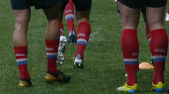 Feet of running rugby players Stock Footage