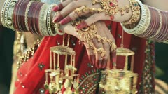 Shot of a Indian bride putting on bangles in her hand Stock Footage