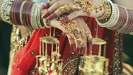 Stock Video Footage of Shot of a Indian bride putting on bangles in her hand