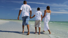 Healthy Young Ethnic Family Walking Beach - stock footage