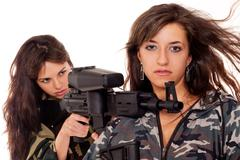 Two armed girls Stock Photos