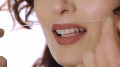 Close up of mouth and dental floss Stock Footage