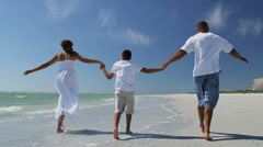 Happy African American Family Outdoors Beach Vacation - stock footage