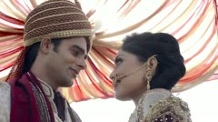 Indian bride and groom in traditional wedding dress talking to each other Stock Footage