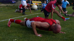 rugby player does push-ups - stock footage