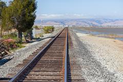 Railroad tracks fading into distance Stock Photos