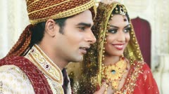 Shot of Indian bride and groom smiling and posing Stock Footage