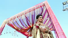 Shot of a Indian bride smiling and posing under a mandap Stock Footage