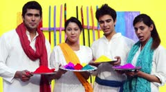 Shot of four friends celebrating Holi festival with colors Stock Footage