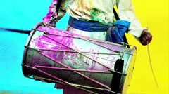 Locked-on shot of a man playing dhol during holi festival Stock Footage
