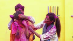 Shot of four friends enjoying Holi festival with colors Stock Footage