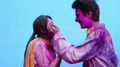 Shot of a smiling couple celebrating Holi festival Stock Footage