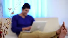 Shot of a man using a laptop and smiling Stock Footage