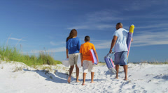 Happy African American Family Carrying Beach Equipment - stock footage
