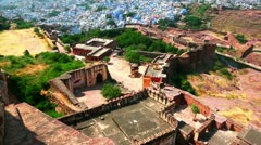 Tilt up shot of a fort with city in the background Stock Footage