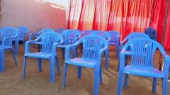 Locked-on shot of chairs Stock Footage