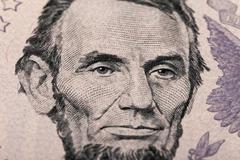 fragment of five dollars bill - stock photo
