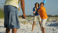 Stock Video Footage of Ethnic Parents Son Playing Baseball Beach