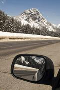 Driver checks rear view mirror motoring north cascades washington state Stock Photos