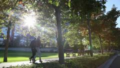 People walking and cycling in the park Stock Footage