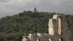 Odeon of Herodes Atticus and hillside, medium shot Stock Footage