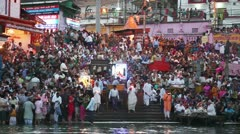 Pan shot of pilgrims at the ghat of Ganges River - stock footage