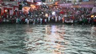 Stock Video Footage of Pan shot of pilgrims at the ghat of Ganges River