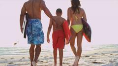 Young Boy Parents Beach Bodyboard Surfboard - stock footage