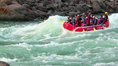 Pan shot of people rafting in a river Stock Footage