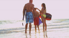 Ethnic Family Water Lifestyle Carrying Surf Boards - stock footage