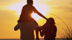 Happy Ethnic Parents Son Sunset Beach Vacation Stock Footage