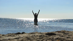 Naturist female enjoying the sea (model release) Stock Footage