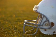 American football helmet on field Stock Photos