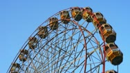 Stock Video Footage of Locked-on shot of a ferris wheel in motion at Pushkar Fair