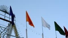 Locked-on shot of boat swing ride in an amusement park at Pushkar Fair Stock Footage