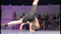 Break dancer spinning dancing head on floor, male performance, click for HD Stock Footage