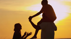 African American Family Sunset Playing Beach - stock footage