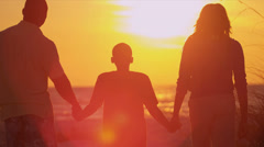 African American Family Enjoying Beach Sunset - stock footage