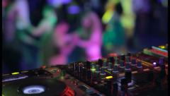 Strobe light, night club audio engineer controls levels dancing, click for HD Stock Footage