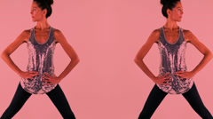 Yoga teacher poses symetrical Stock Footage