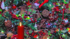 Red holiday candle with autumn decorations in background Stock Footage