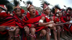 Pan shot of Naga tribesmen dancing in Hornbill Festival Stock Footage