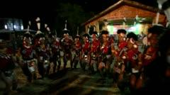 Pan shot of Naga tribesmen dancing in Hornbill Festival Stock Footage