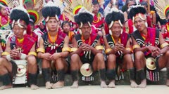 Pan shot of Naga tribesmen in traditional outfit during Hornbill Festival Stock Footage
