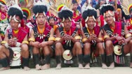 Stock Video Footage of Pan shot of Naga tribesmen in traditional outfit during Hornbill Festival
