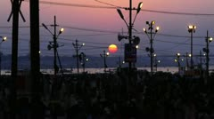 Time lapse shot of Hindu pilgrims at riverbank during Kumbh mela Stock Footage