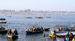 Locked-on shot boats in a river during Kumbh Mela Stock Footage