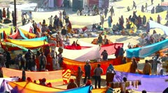Locked-on shot of Hindu pilgrims at riverbank during Kumbh mela - stock footage