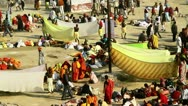 Stock Video Footage of Locked-on shot of Hindu pilgrims at riverbank during Kumbh mela